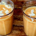 Tropical Smoothie with Mango, Carrot and Coconut Flakes