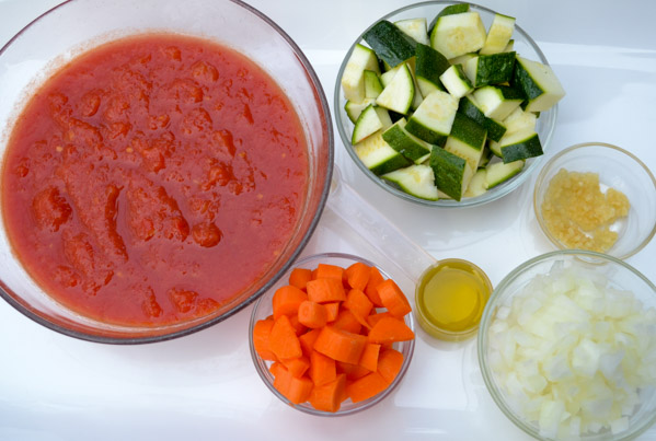 crushed tomatoes, carrots, zucchini, onions, garlic and olive oil