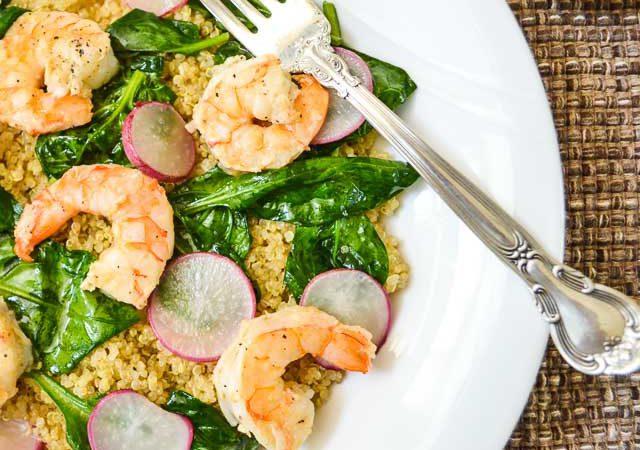 Plated Lemony Shrimp Quinoa Bowl with Lemon