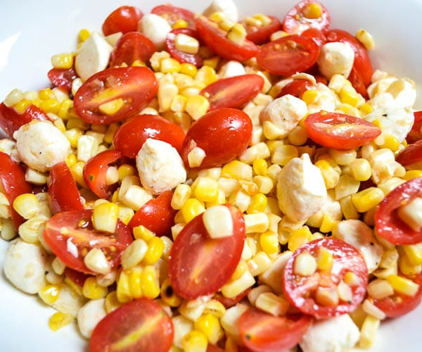 close-up of prepared grilled corn and tomato salad with white wine vinaigrette