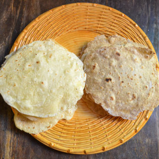 overhead view of white and wheat tortillas on yellow plate