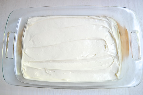 cream cheese and whipped topping mixture spread over pretzel crust