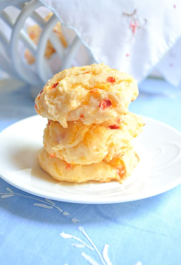 three stacked easy pimento cheese biscuits on plate