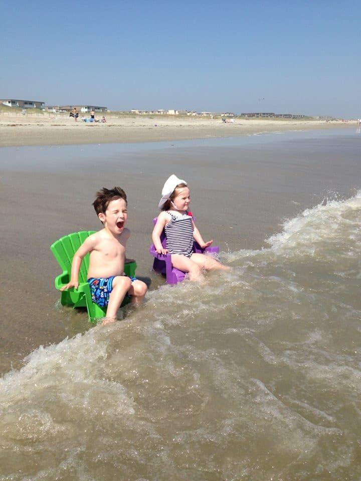 kids sitting in chairs in waves