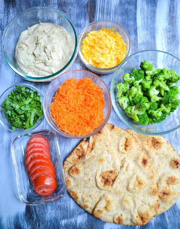 individually prepped ingredients for rainbow vegetable hummus flatbread