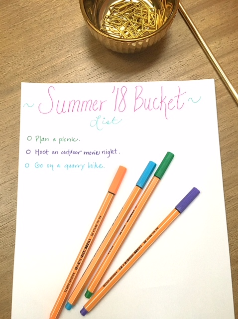 summer '18 mulitcolor bucket list on desk with colored pens