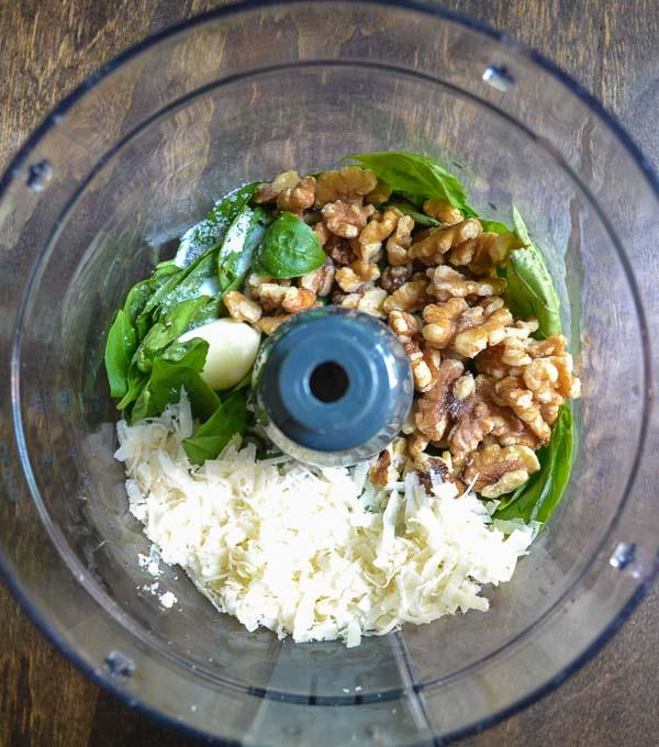 easy basil pesto recipe ingredients in food processor bowl