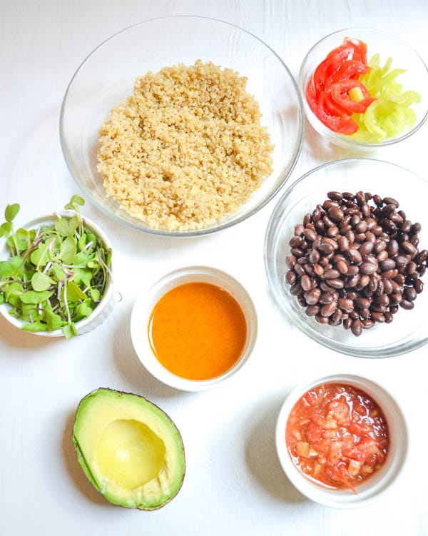 prepped ingredients for Tangy Southwest Salad in bowls with Lime Vinaigrette