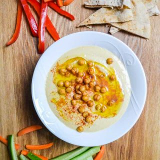 Classic Hummus garnished with olive oil, paprika & crispy chickpeas with pita and crudites