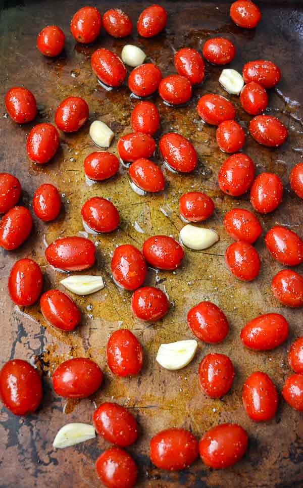 Marinated Grape Tomatoes and Garlic on Sheet Pan for Slow Roasted Grape Tomatoes recipe