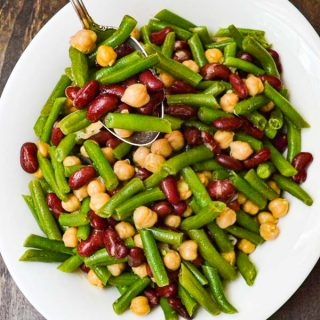 Easy Three Bean Salad in serving dish with serving spoon.