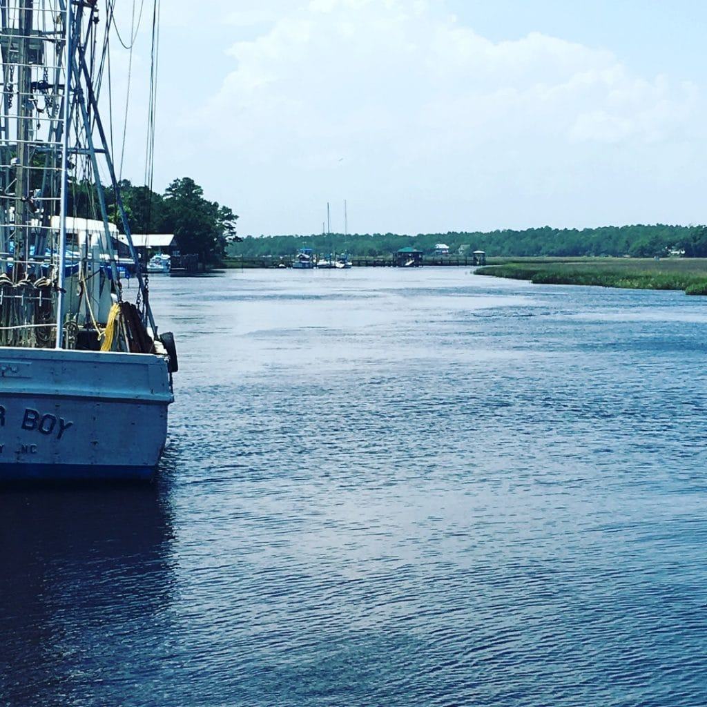 back of shrimp boat in inlet water