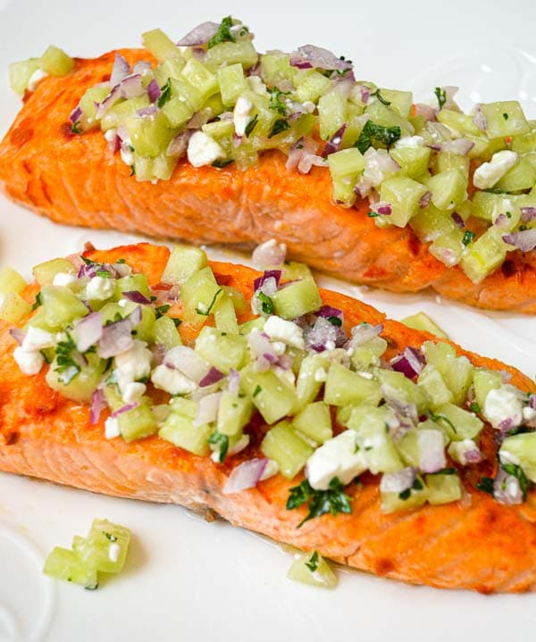 prepared parchment baked harissa salmon topped with cucumber relish