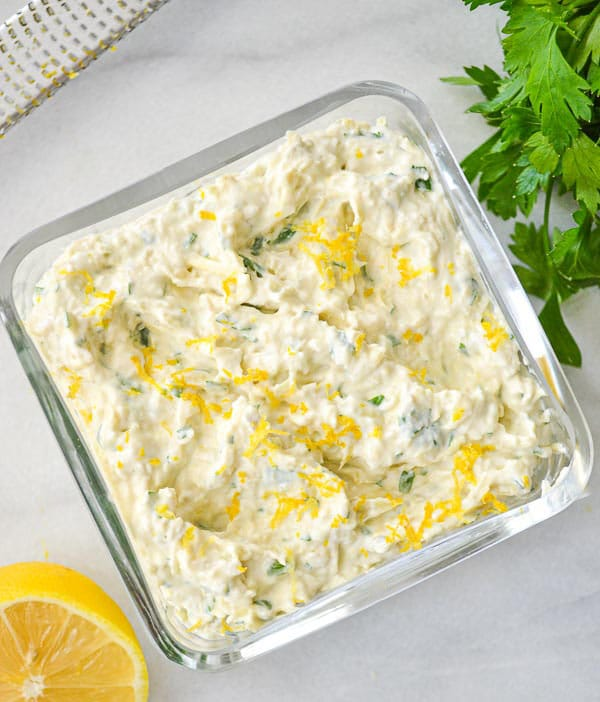 artichoke dip garnished with lemon zest